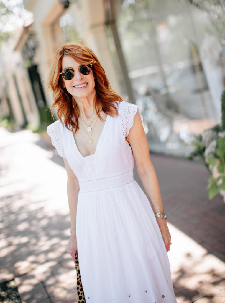 Cathy is wearing a J. Crew white dress - The Middle Page