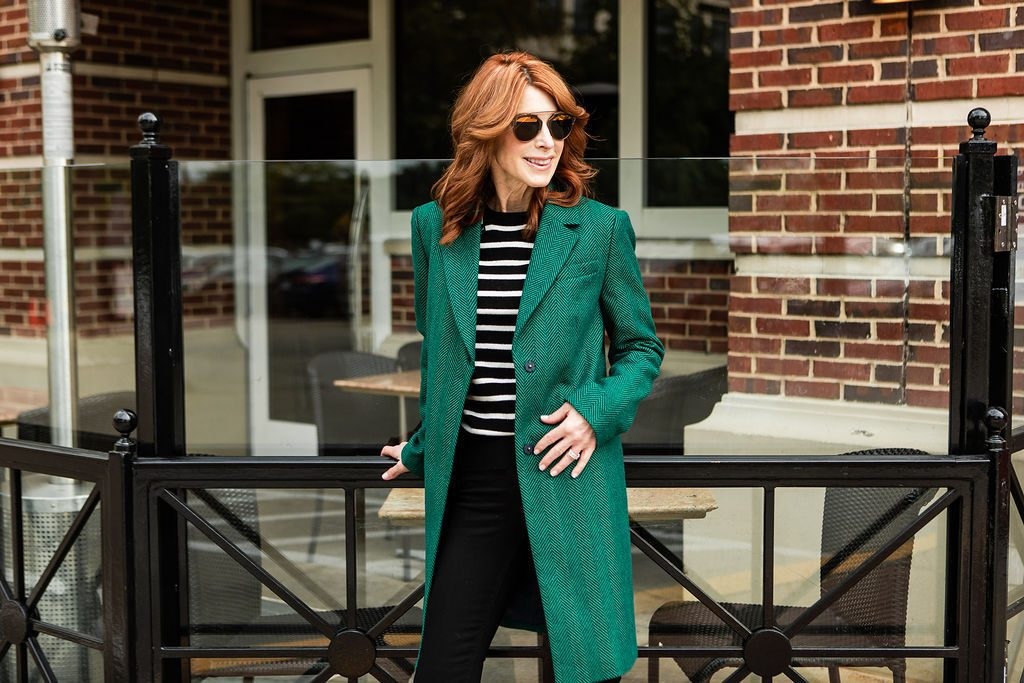 Green Coat with Black and White Striped Sweater Marks and Spencer
