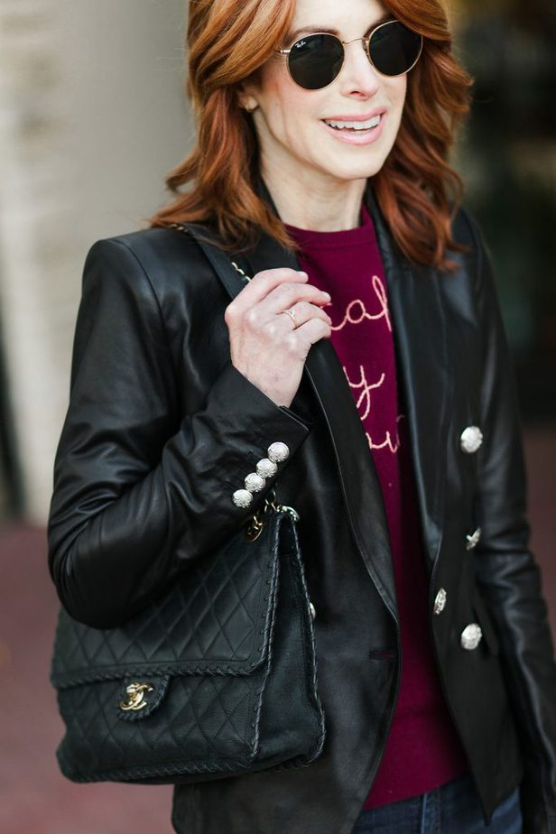Black leather jacket with Cake by the Pound burgundy sweater