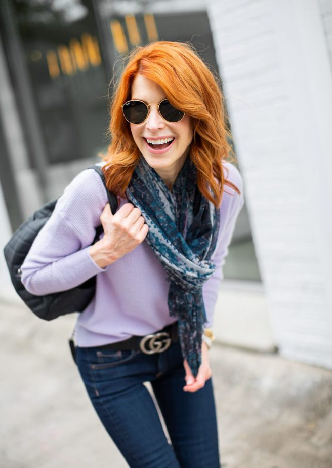 Lavender sweater with blue scarf and jeans by Cathy Williamson