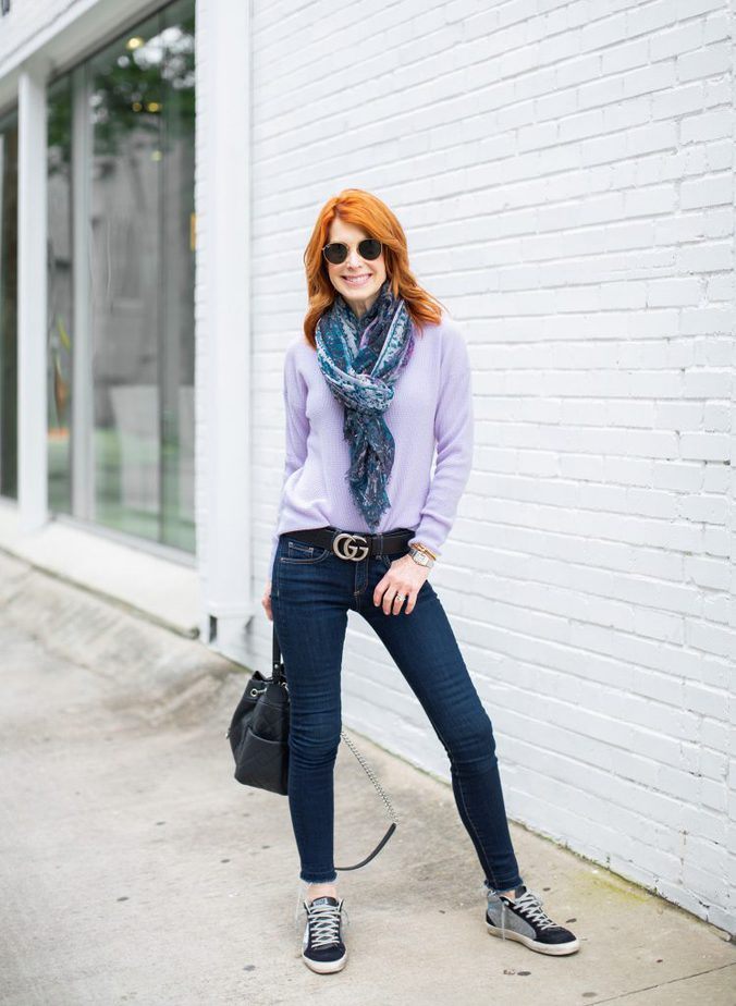 Cathy Williamson is featuring a lavender sweater with blue scarf and jeans
