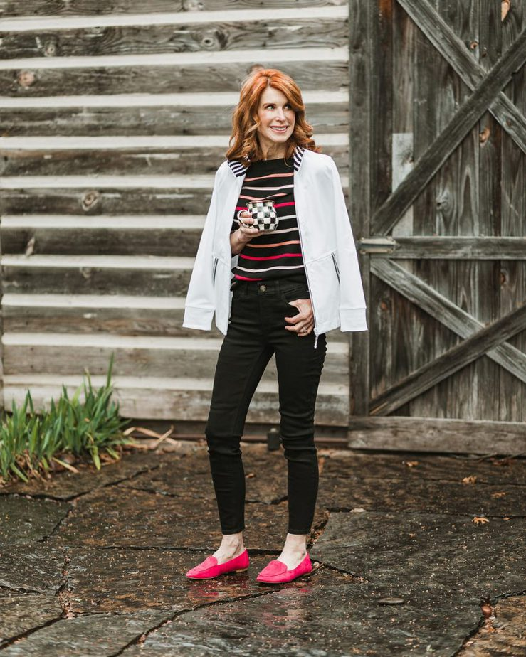 White Jacket with Black Striped Sweater, Black Jeans, and Pink Loafers by The Middle Page