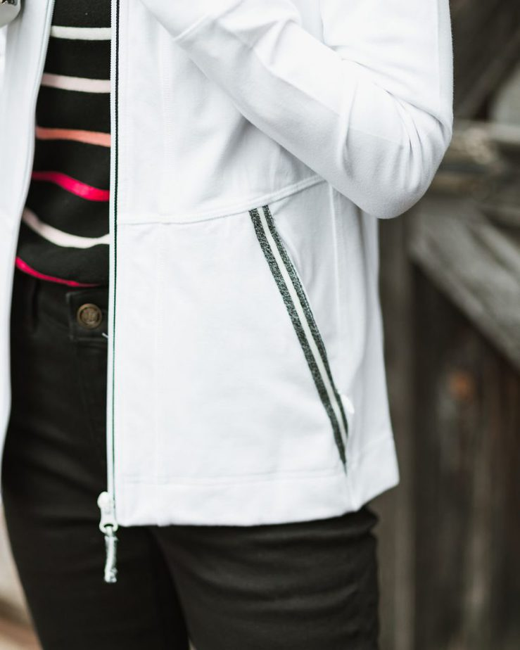 White Jacket with Black Striped Sweater, Black Jeans, and Pink Loafers