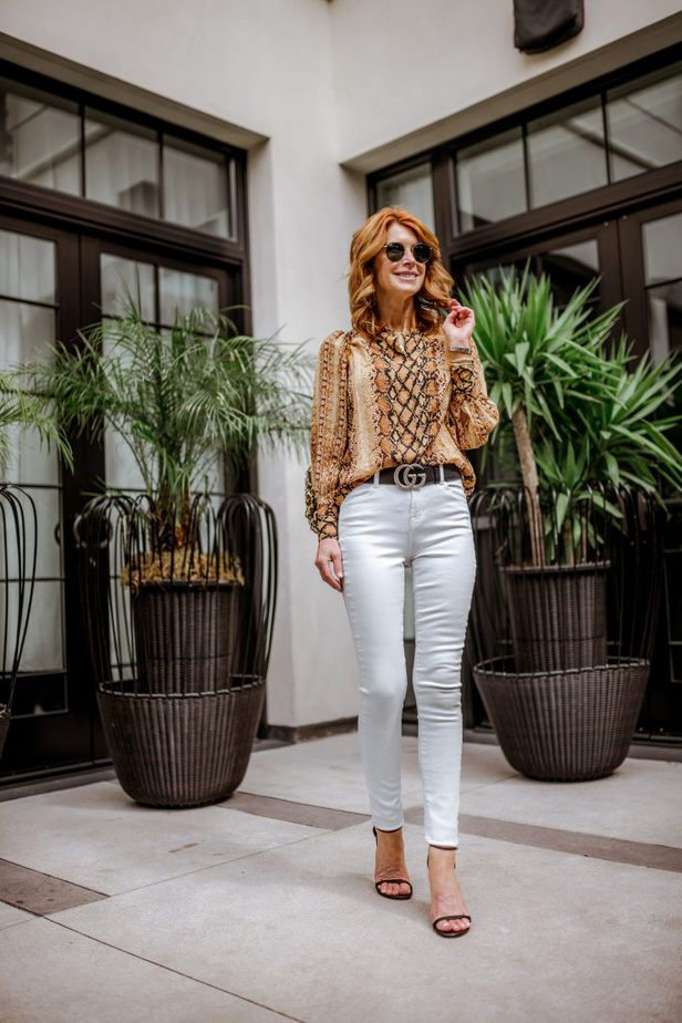 golden color snake print button-up top + gucci belt + white jeans