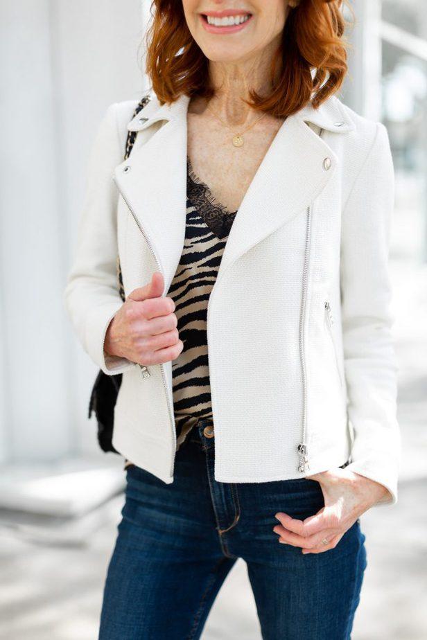White Moto Jacket with Zebra Stripe Cami and Dark Jeans
