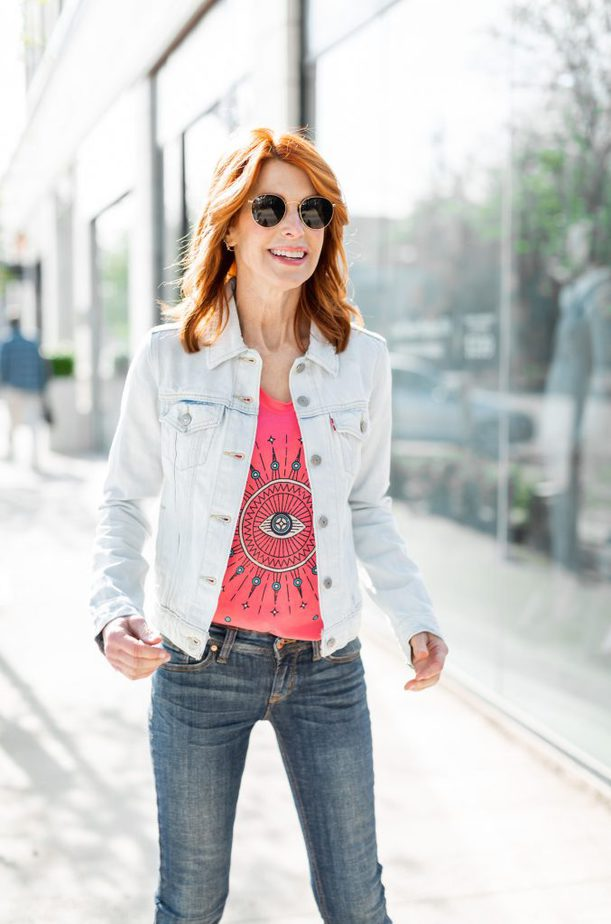 Pink Evil Eye Graphic Tee with Light Denim Jacket and Jeans