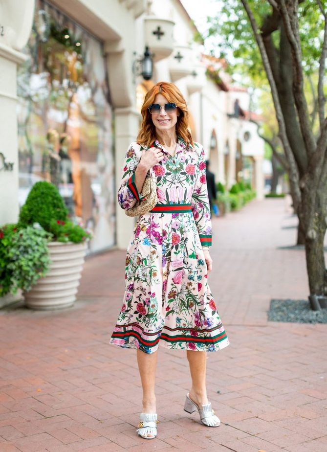 Pink floral dress with red and green ribbon