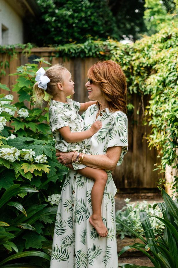 Cathy and her granddaughter are wearing Palm Leaf Print Dresses with Matching Childs