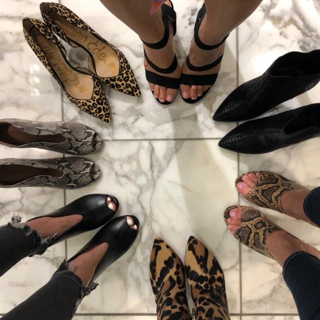 Shoes starting clockwise: Strappy Sandal, Black Bootie, Snakeskin Mule, Leopard Bootie, Black Bootie, Snakeprint Bootie, Leopard Pump