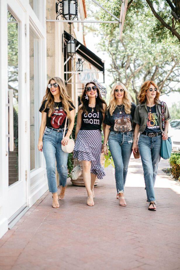 four women walking down the street