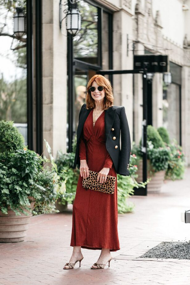 Rust dress with black jacket on Dallas blogger