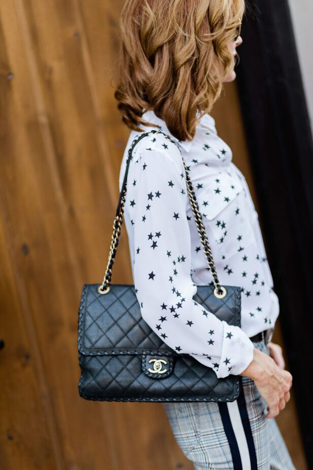 Black Chanel Bag with Star Print Blouse on Dallas blogger