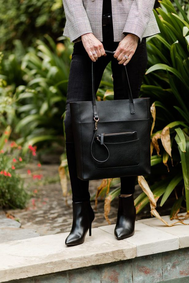 Black Jeans Paired With Plaid Blazer And Black Handbag from JC Penny