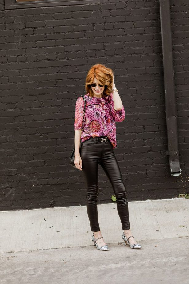 Coach blouse paired with black pants