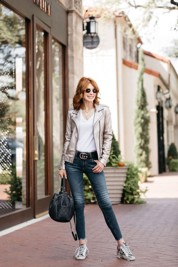 The Middle Page blog wearing chic Moto jacket with jeans and Golden Goose sneakers