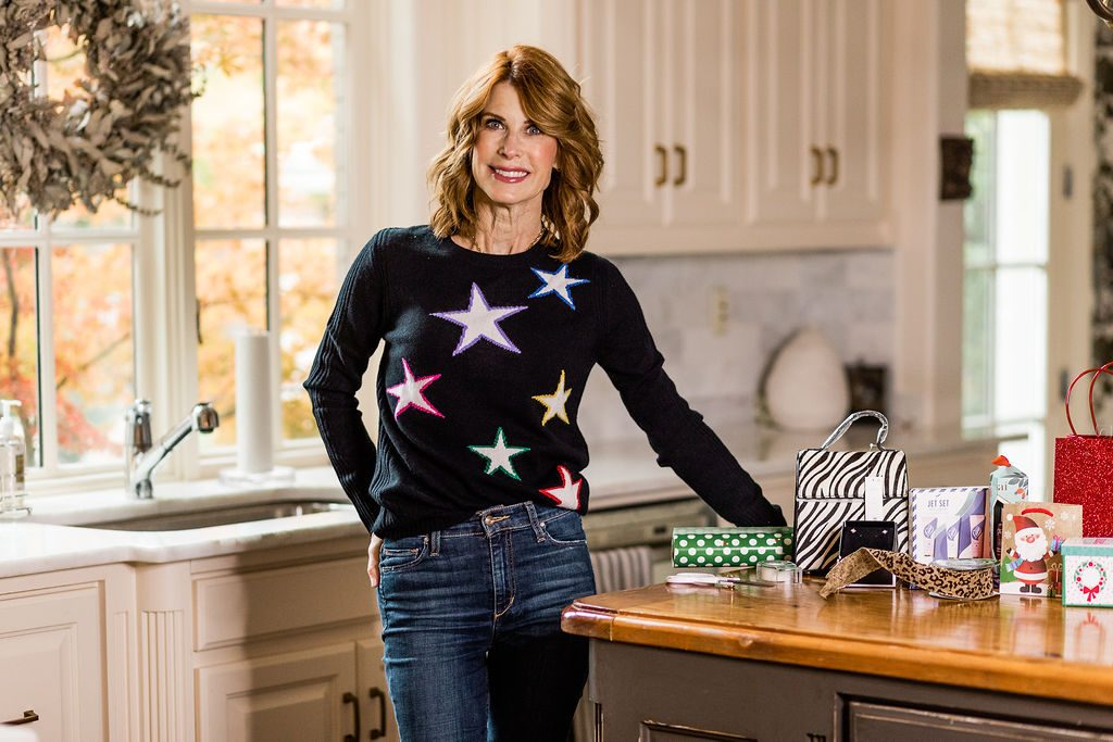 Cathy Williamson wearing AQUA Star Intarsia Cashmere Sweater from Bloomingdales