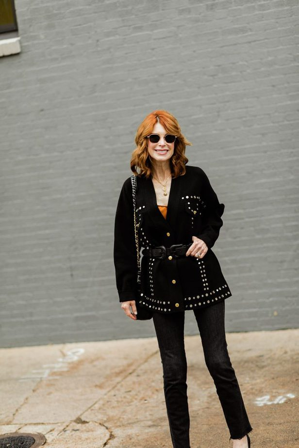 Cathy Williamson wearing black belted cardigan by Sandro