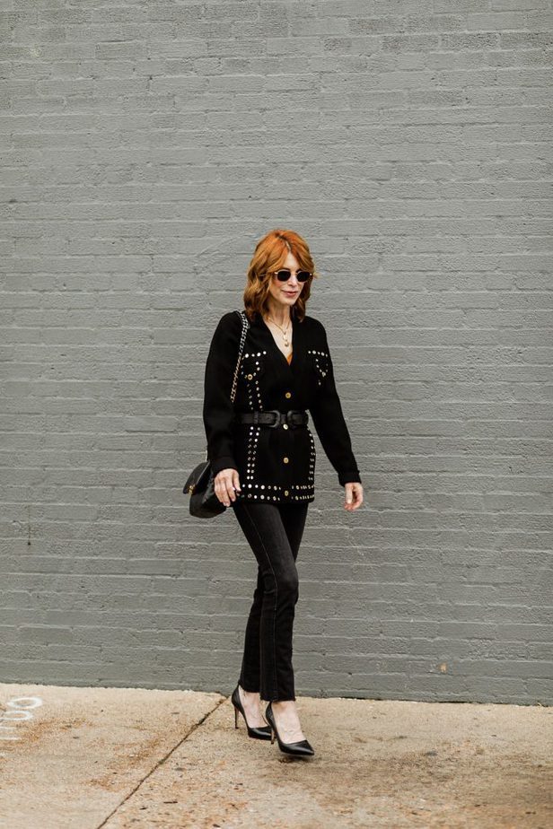 Cathy Williamson wearing black jeans by Frame with black cardigan by Sandro