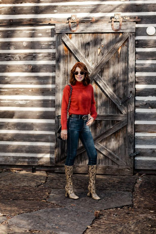 Cathy Williamson wearing Lou & Grey Cozy Sweater paired with jeans and Gucci Belt