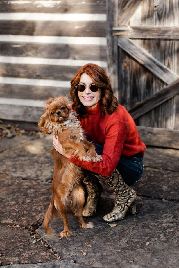 Cathy Williamson wearing cozy sweater from Lou & Grey with dog Maisie