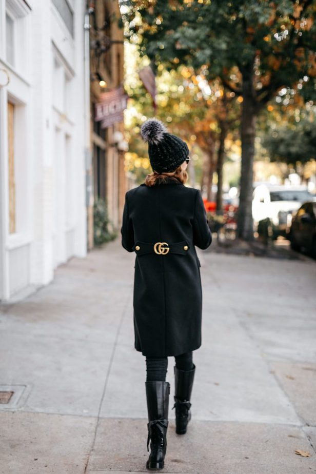 The Middle Page wearing black Gucci wool coat with double G