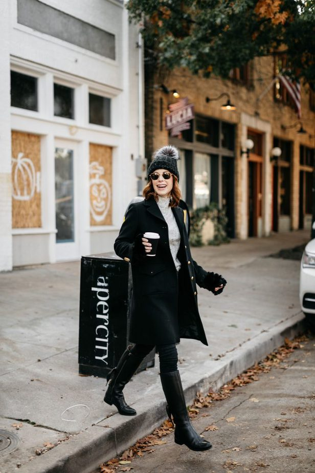 Over 50 Dallas Blogger wearing black wool Gucci coat with jeans and black boots