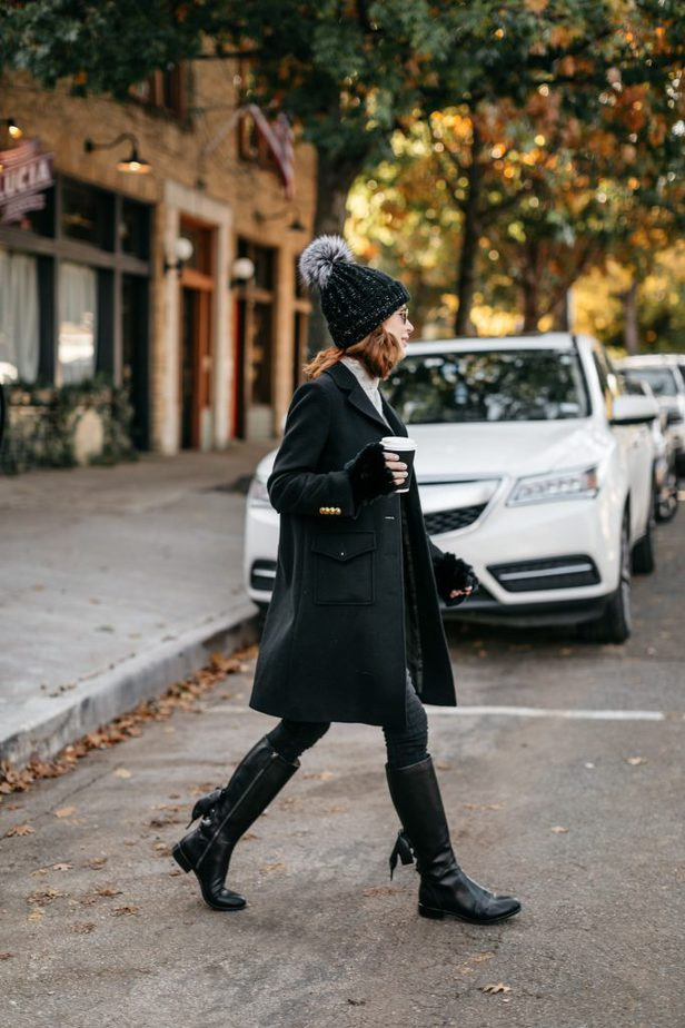 Cathy Williamson wearing black wool Double G Gucci Coat