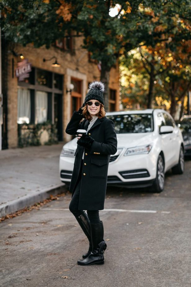Cathy Williamson wearing black Gucci coat with fur gloves and grey beanie in Dallas
