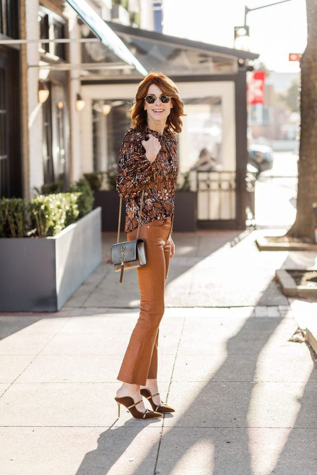 Cathy Williamson Wearing Caramel Frame Leather Pants and YSL Purse
