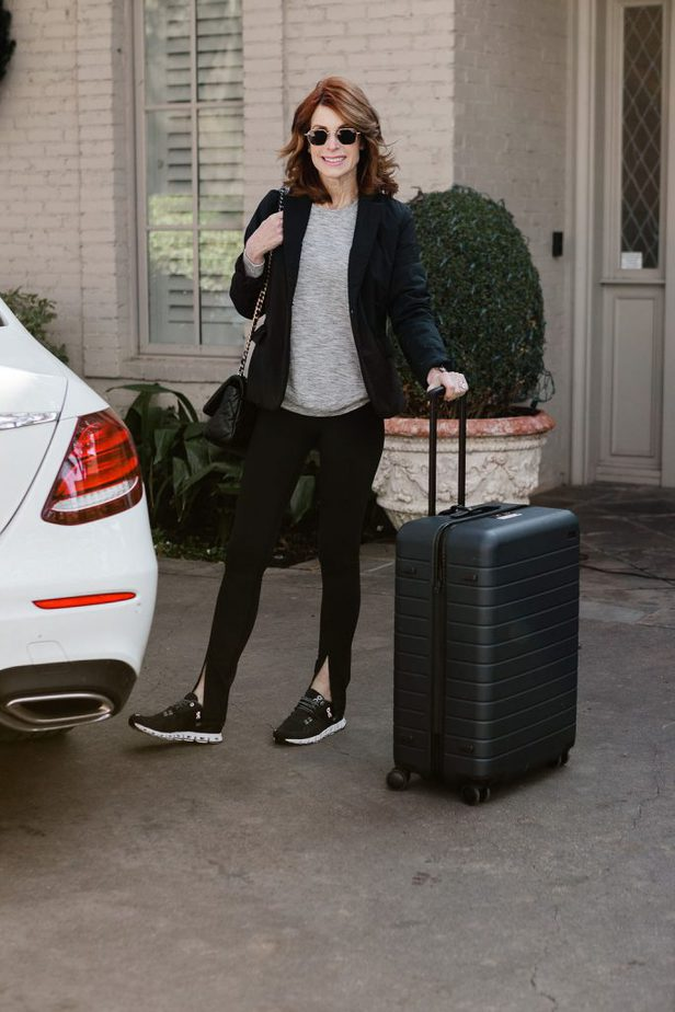 Over 50 Fashion Blogger wearing leggings and jacket from Athleta for Travel