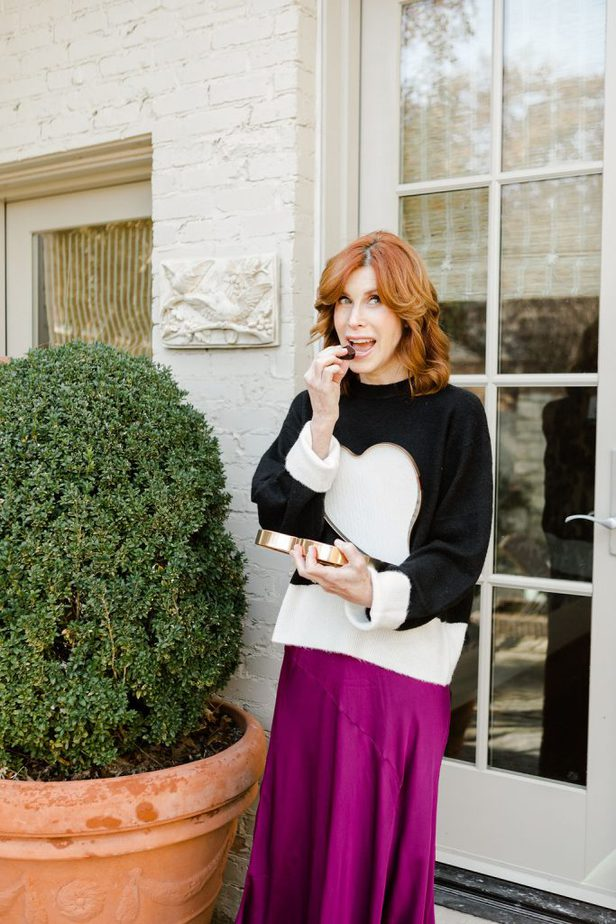 Cathy Williamson wearing black and white H&M knit sweater