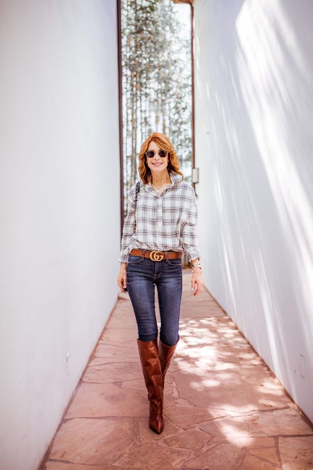Dallas Blogger wearing brown boots from Paris, Texas with plaid shirt and jeans