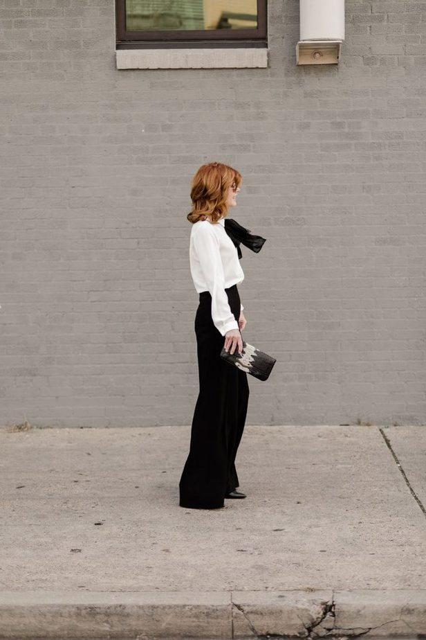 Classic and timeless look, The Middle Page wearing blouse and pants from Anne Fontaine