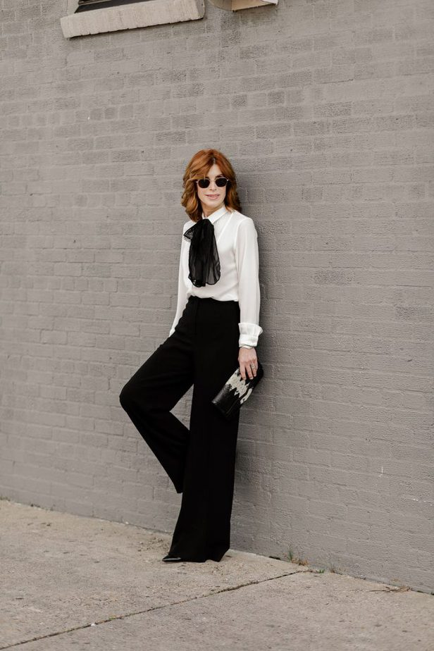 Cathy Williamson wearing Anne Fontaine wide leg pants with white blouse