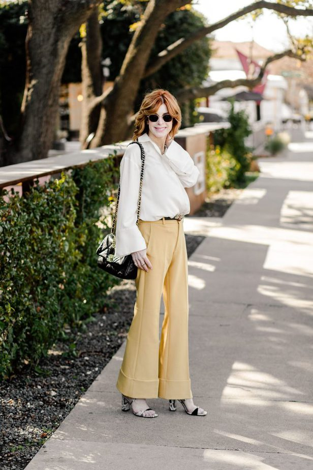 Cathy Williamson wearing yellow trousers from Club Monaco
