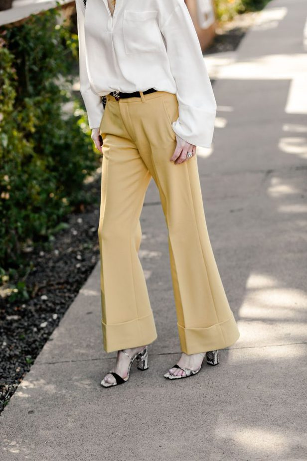The Middle Page pairing white blouse with yellow pants from Club Monaco