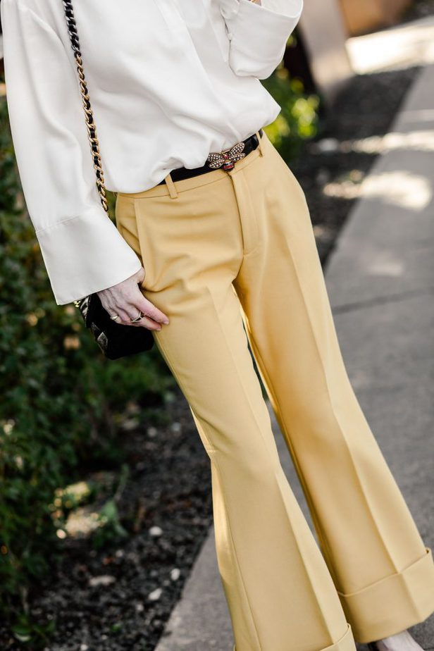Over 50 Fashion blogger wearing yellow trousers from Club Monaco