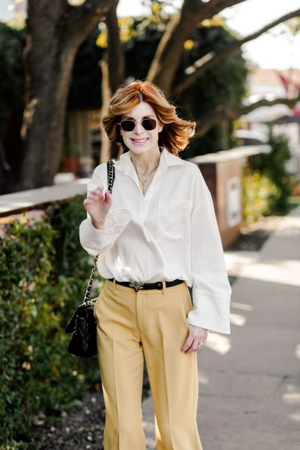 Cathy Williamson with white blouse and yellow pants from Club Monaco