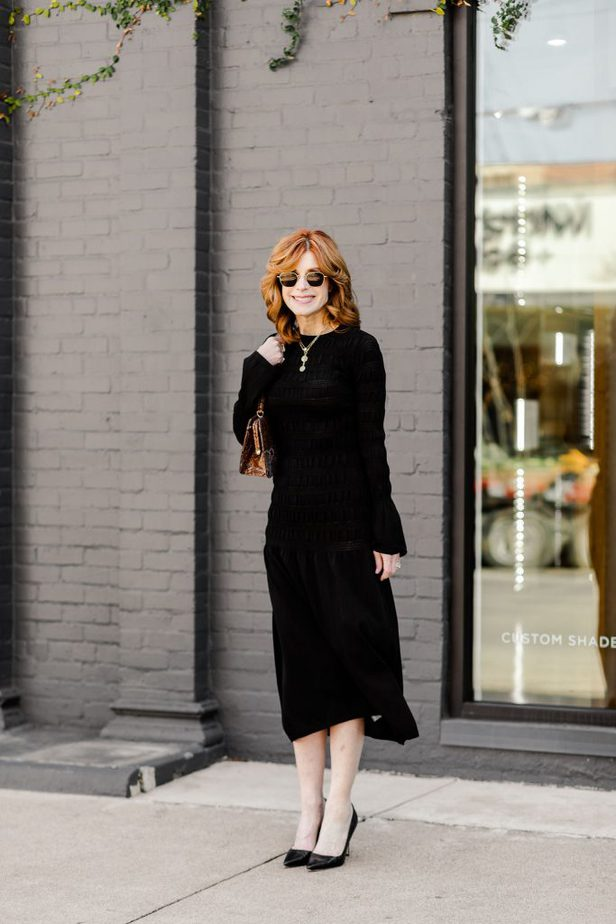 Cathy Williamson wearing black puckered dress from H&M