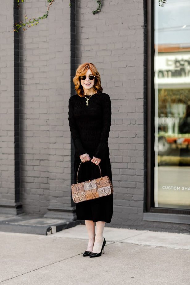 The Middle Page wearing black smocked H&M dress with Moda Operandi Handbag