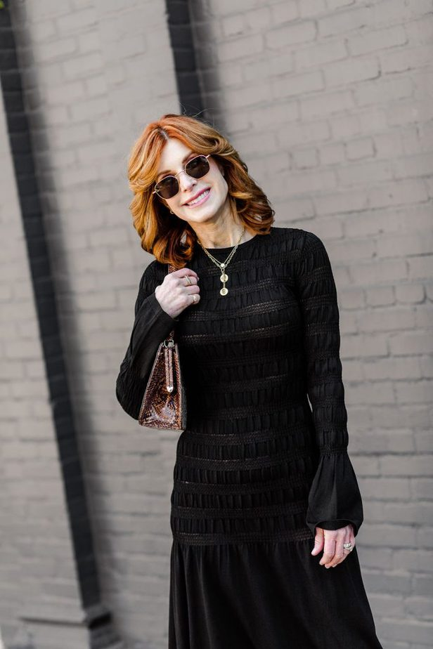 Cathy Williamson puckering up in black H&M dress
