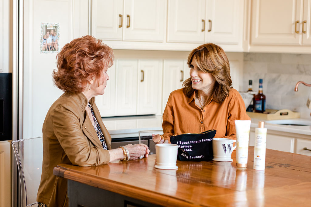 Cathy Williamson sharing beauty tips with her mom