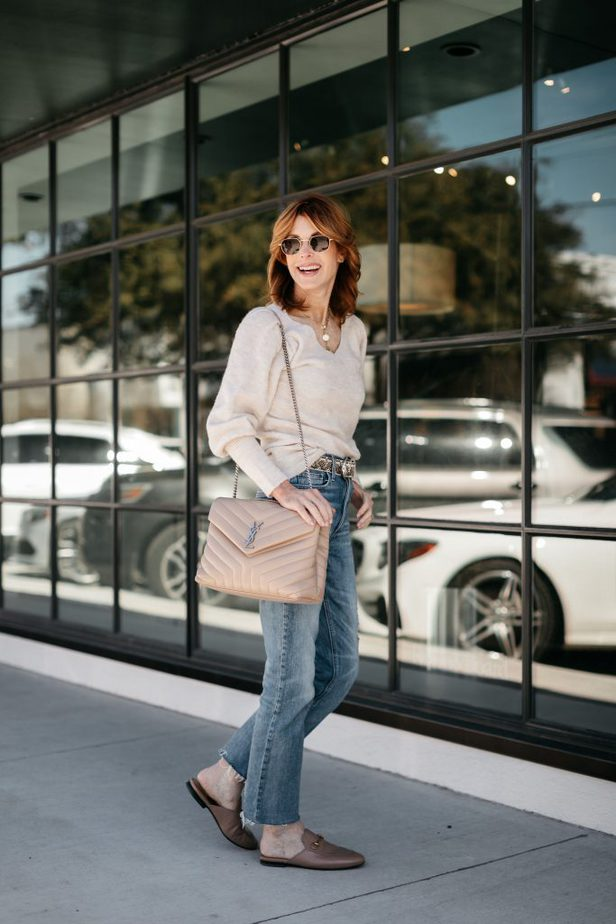 Cathy Williamson wearing Rachel Parcell puff sleeve sweater with jeans and YSL purse