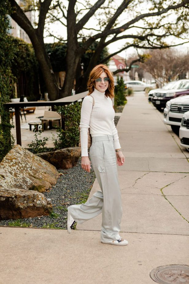 the Middle Page wearing Club Monaco carpenter style pants