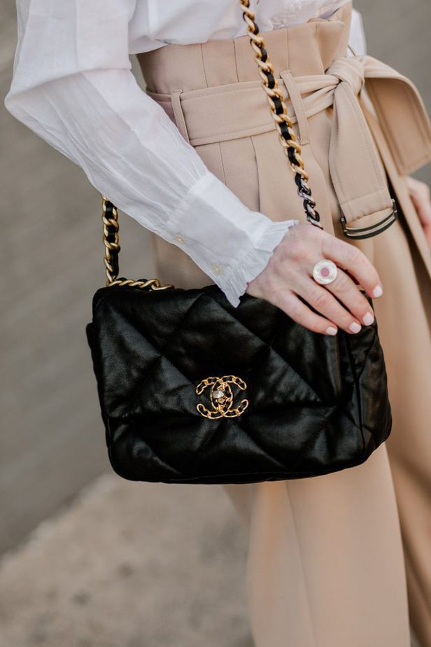 JUDITH & CHARLES PAIRED WITH BLACK CHANEL PURSE