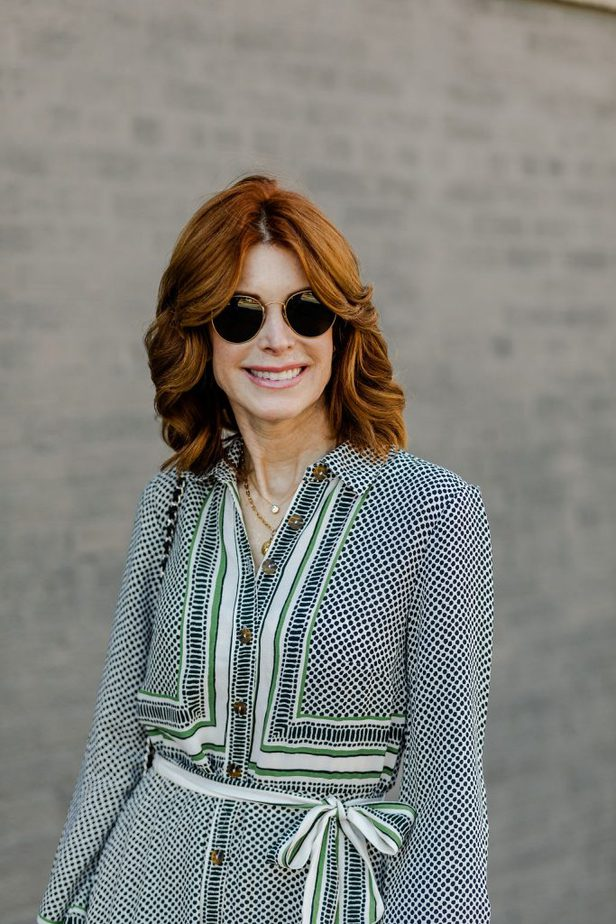 Cathy Williamson wearing green dress from Anthropologie
