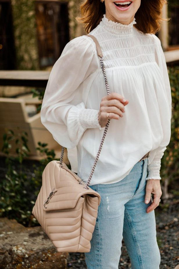 Dallas Blogger wearing white ShopBob blouse with light wash denim jeans