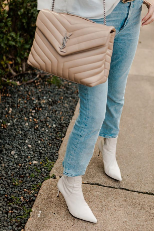 YSL Nude purse paired with light denim jeans