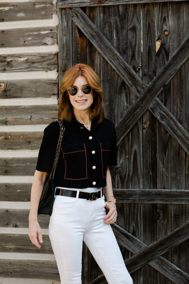 Over 50 Fashion Blogger wearing Sandro Cardigan and white jeans