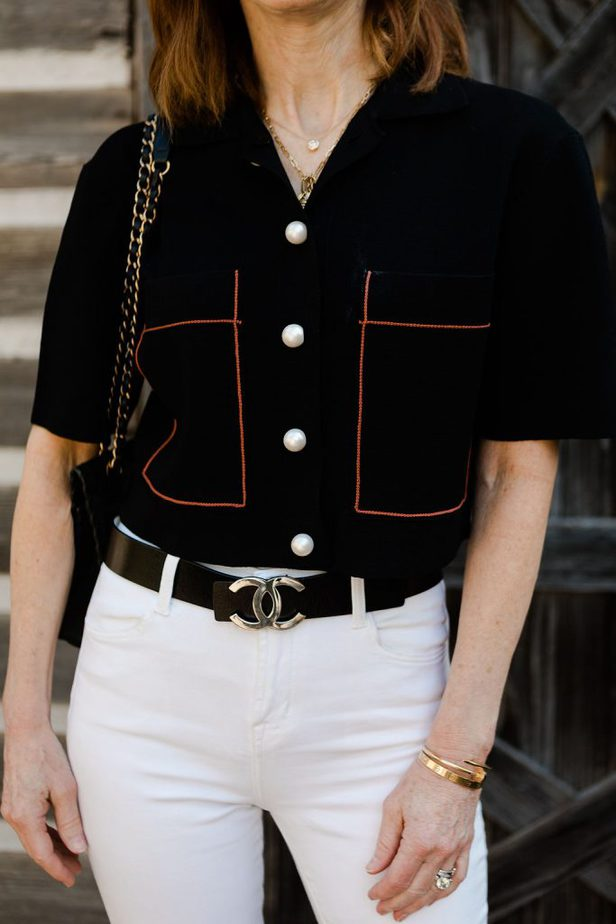 Cathy Williamson wearing Sandro Cardigan with Pearly Buttons and White Jeans with a Chanel Belt